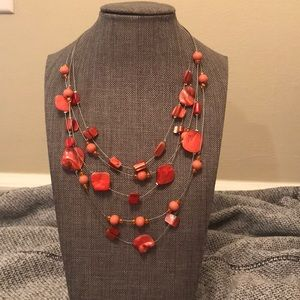 Salmon colored beaded necklace
